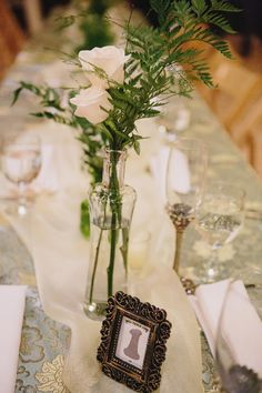 simple centerpiece, photo by Sun and Life Photography http://ruffledblog.com/swedish-american-hall-wedding #weddingideas #centerpieces