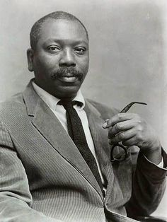"""Jacob Lawrence, painter. He is among the best-known 20th-century African-American painters, a distinction shared with Romare Bearden. He was only in his twenties when his """"Migration Series"""" made him nationally famous; the series depicted the Great Migration of hundreds of thousands of African Americans from the rural South to the urban North. He referred to his style as """"dynamic cubism"""", though by his own account the primary influence was not French art, but the shapes & colors of Harlem…"""