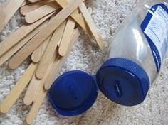 Popsicle sticks into a mayo container. Fine motor development for little ones.