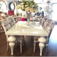 Gorgeous gloss table with crushed velvet chairs. Glam dining
