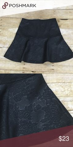 "Black Flare Skirt with Design Black Flare Skirt with Faux Leather look embossed flower design by Frenchie - sold at Nordstrom's.  Pre-owned, excellent condition.   Length: 17""        Waist: Flat lay measures 13""  Material: 100% Polyester Frenchie Skirts Mini"