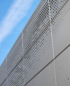 Image 1 of 2 - A very cool perforated privacy screen on a law office in Chicago.  When back lit it looks like the ends of a fiber optic cable.  Materials perforated by Accurate Perforating, Chicago, IL