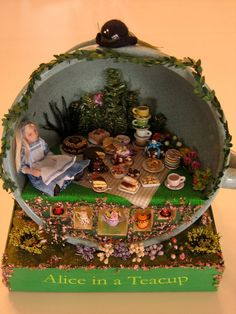 Alice in a teacup by Goldie Holl, via Flickr ||| doll, This takes first place in my books for scenes in a teacup.