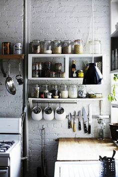 Kitchen shelving and hooks for pantry items.