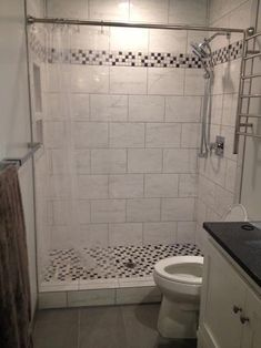 From LOWES Shower Surround Tile Blairlock White Ceramic Tile - 8 x 16 white ceramic tile