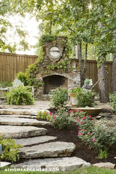 The fireplace, which is located at the far side of the garden, is a quiet retreat that Beebe says she enjoys using year-round.  During the renovation, a koi pond was removed from a space near the fireplace. To incorporate a new water feature, Beebe asked for a fountain that would provide a soft, tranquil sound. | European Rendition | At Home in Arkansas | March 2016