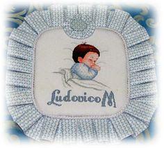 Cuscino nascita ludovico - Dall'album di Nonnamiry: http://www.megghy.com/album/nonnamiry/punto_croce/cuscino-nascita-ludovico.html