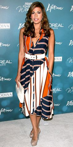 Eva Mendes wearing a sporty striped Salvatore Ferragamo dress with a white belt from the brand and patent Sergio Rossi peep-toes.