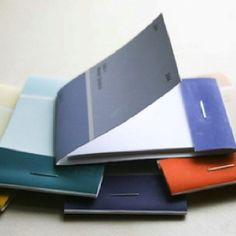 Paint chip notebook. Would be so cute in the rainbow colors for party favors.