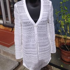 White long cardigan. Very pretty lace knit white cardigan. It no longer has any tags. It is in very good condition and it fits like a size large. Sweaters Cardigans