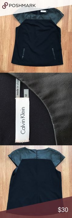 NWT Calvin Klein Sleeveless Black Top Calvin Klein Sleeveless Black Top with faux leather at top and front pockets. Zips in back. New with tag (attached inside). Jeans listed separately. Calvin Klein Tops Blouses