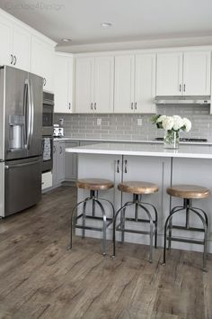 My friends gorgeous gray and white kitchen - vinyl plank flooring and wood and metal counter stools in grey and white kitchen - Kitchen Remodel, Kitchen Design, Kitchen Vinyl, Kitchen Cabinets And Countertops, Modern Kitchen, White Kitchen Design, Grey Kitchens, Wood Floor Kitchen, Grey Kitchen Floor