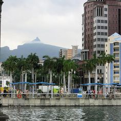 View from harbour front walk in Port Louis. Le Pouce mountain as backdrop to…