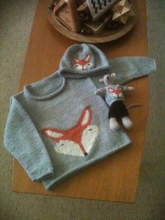 Boy's jumper with a fox on the front with a matching hat and a mouse with a matching jumper. I really enjoyed knitting this.