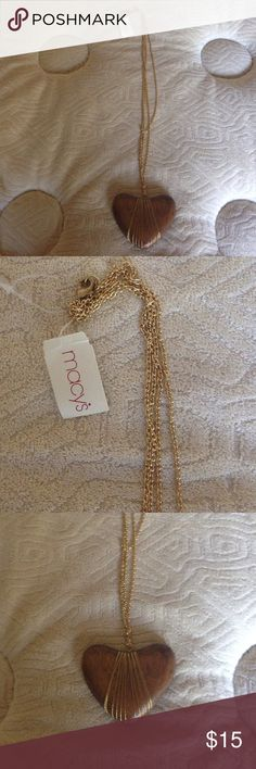 Macy's Wooden with golden decoration medallion NWT New with Tag wooden heart medallion with golden decoration on the golden chain. Nice custom Jewelry piece. Macy's Jewelry Necklaces