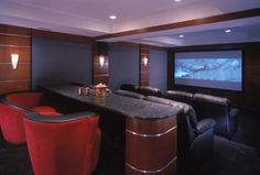Art Deco Home Theater with Vladimir Kagan Nautilus Chair 9444, Wall sconce, Lane 175 Grand Slam Theater Seating, Exposed beam