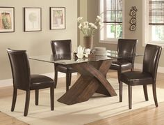 Make a bold statement in your casual or formal dining room with this table. It features a large scaled X base design with rectangular glass top. The base is crafted from ash veneers and finished in a deep brown tone. The unique base will create a modern look for your dining room