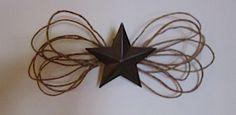 Wired grapevine and a metal star make up this simple decor item.