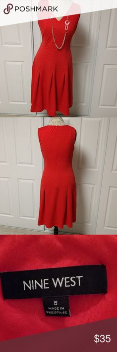 Beautifully Soft Red Nine West knit dress Beautifully Soft Red Nine West knit dress with pleats, v-neck, and pattern on pattern. Necklace sold under jewelry Nine West Dresses