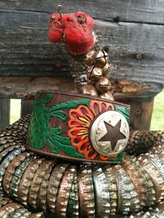 Hand-painted embossed leather cuff with sweet iron and silver-toned star concho. $20.00, via Etsy.