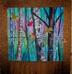 Landscape quilt-Its made with fabric strips, water soluble glue sticks and laundry markers. Fast and easy to do . The embellished leaves were purchased in a pack of 50 for $1 .
