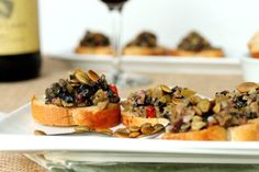 Olive Tapenade with Pepitas on Garlic Toast