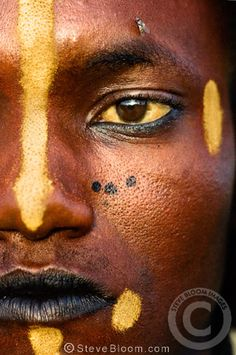 A Wodaabe man with face paint during the Gerewol festival, north of Abalak, Niger