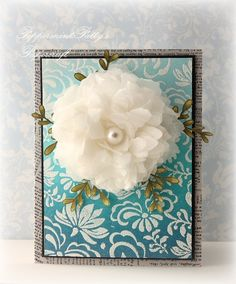 Tattered Florals tissue flower on a Seafoam EP-embossed DI-inked card front