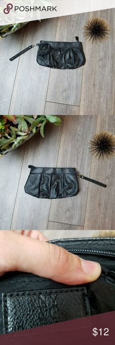 NY & Co black clutch Cute black even clutch. Very simple with cute black flower. Nice size to carry essentials. Inside zipper pocket. Used once. New York & Company Bags Clutches & Wristlets