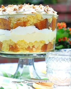 Deliciously dreamy Coconut Pineapple Trifle dessert recipe with crushed pineapple, moist yellow cake, cream cheese & pudding filling, piled high with whipped topping. Recipes With Crushed Pineapple, Pineapple Dessert Recipes, Pineapple Cake, Fruit Recipes, Pineapple Pudding, Party Recipes, Brunch Recipes, Trifle Pudding, Pudding Desserts
