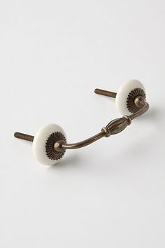 Zinnia Handle - Antique Brass #anthropologie - these will be for the drawers. Luckily, there are only a few drawers otherwise this would get too expensive.