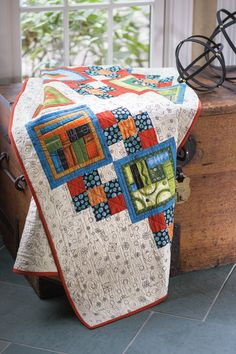 Designer Diane Nagle was inspired by the panel prints which reminded her of abstract sculptures. She constructed paths to connect each one. This quilt features fussy cut bordered squares and path blocks and finishes with a straight-grain French fold border.