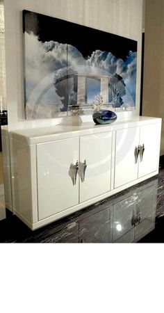 Luxury white cabinet.  Discover more: www.buffetsandcabinet.com  | #cabinetdesign #whitecabinet #livingroomcabinet
