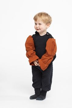 Eco Kids Clothes | One-piece quilted bib in soft jersey fabric made from organic cotton with buttons at the shoulders. Small pocket on the right back. A wonderful addition to your darlings wardrobe. Explore our organic kids clothing in black at https://www.infantiumvictoria.com/collections/urgothic-collection/products/bib | Sustainable Fashion