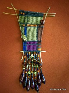 This is my first Cavendoli art piece. Cavendoli is a form of macrame and is comprised of horizontal and vertical half hitch knots. In this c...