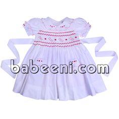 Beatiful geometric smocked dress for girls http://babeeni.com/Detail-beatiful-geometric-smocked-dress-for-girls---dr-2248-6109.aspx