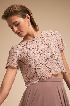 This feminine top brings a soft elegance to your look with short sleeves, jewel neckline, and scalloped floral lace. Only available at BHLDN Pictured with Luanne Earrings, Calynda Heels Bridesmaid Separates, Modest Bridesmaid Dresses, Prom Dresses, Formal Dresses, Crop Top Outfits, Skirt Outfits, Summer Day Dresses, Evening Dresses, Saree Blouse Neck Designs