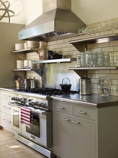 The stainless steel shelving coordinates beautifully with the countertops, hood + range.
