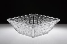 Koko Square Crystal Bowl 22cm Elegant, richly decorated, hand crafted square shaped crystal bowl. This striking work of art will grace any dinner table, also make a beautiful statement piece that will demand attention in its own right.