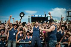 Crowd in blue singlets at Deni Ute Muster Aust