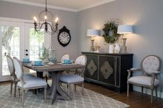 After.  The new dining room comes with loads of natural light, and Joanna's design evokes a fresh French Country feel with solid wood table, neutral grey walls, blue accents and a showpiece chandelier.
