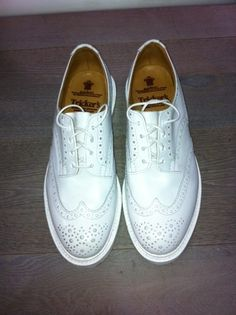 All white Tricker's wingtip brogues
