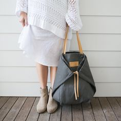 This is a really inventive way to make a large bag smaller using the laces. Forest grey Adventure Tote
