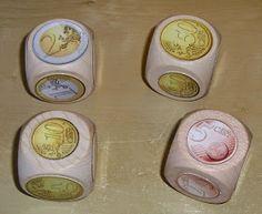 dobbelstenen voorzien van muntstukken en optellen maar... Ben je op zoek naar houten dobbelstenen? http://credu.nl/product/houten-dobbelsteen-40mm-x-40mm/