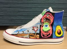 This is a pair of Pearl Jam hi-top Converse, depicting 10 of their album covers…