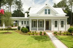 allison ramsey architect.  porte cochere.  The body of the house is Sherwin Williams Useful Grey and the trim id Sherwin Williams Dover White. The Sutters are Historic Charleston Green-Sherwin Williams.
