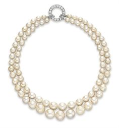 A DOUBLE-STRAND PEARL AND CULTURED PEARL NECKLACE