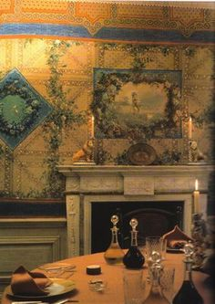 Princess Lee Radziwill's dining room at her English country home Turville Grange.  The walls are covered with Sicilian scarves that have then been lacquered, and then hand painting was done over that.