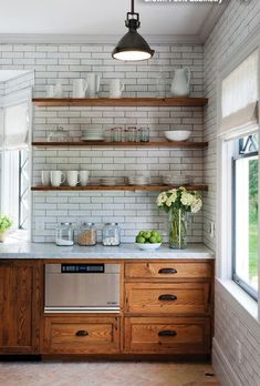 White subway tiles with oak kitchen cabinets and open shelving