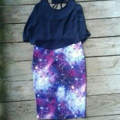 Purple Galaxy Midi Skirt Take your style straight to lightspeed with this uber cool scuba knit midi skirt. With a sexy body con fit and out-of-this-world allover galaxy print, it's sure to become a favorite. Internal elastic waistband.  A 2-piece trend mix and match style! ?95% polyester, 5% spandex ?Machine wash Rue 21 Skirts Pencil